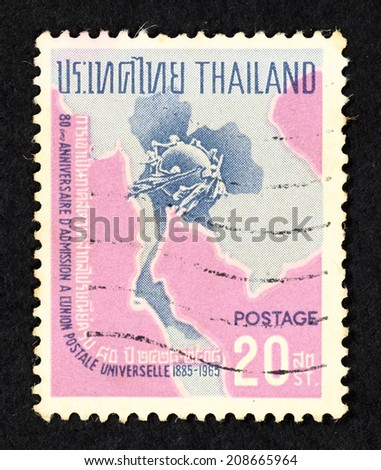 THAILAND - CIRCA 1965: Pink color postage stamp printed in Thailand with image of people encircle a globe on a Thailand map to commemorate 80th Anniversary for the admission to Universal Postal Union. - stock photo