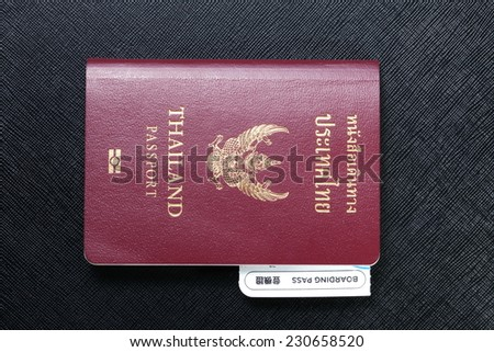 Thailand citizen passport put on the black leather color in the passport has a boarding pass.  - stock photo