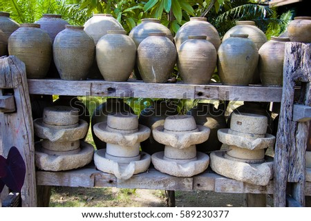 Thailand Clay Jar and Ancient grain grinding millstones.