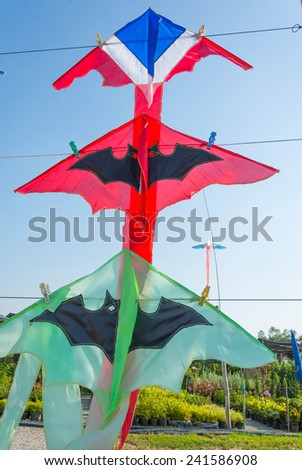 Thailand flag color kite and bat kites hanging on string  - stock photo
