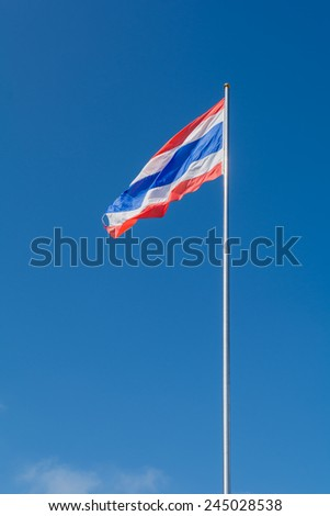 Thailand flag on flagstaff with blue sky background - stock photo