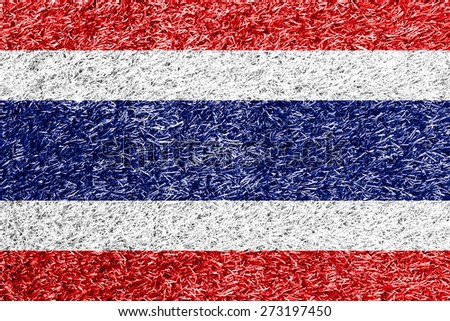 Thailand flag on grass background texture - stock photo
