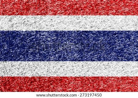 Thailand flag on grass background texture - stock photo