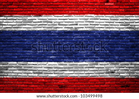 Thailand flag painted on old brick wall texture background - stock photo