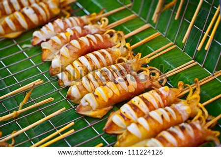 Thailand food - barbecue from squids sold on the street asian market