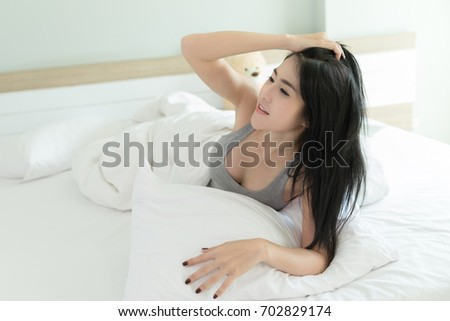 thailand girl dressed sexy model in the white bedroom
