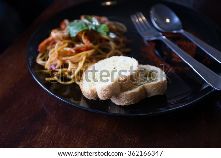 Thailand Hot spicy spaghetti seafood with bread .