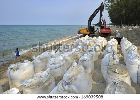 THAILAND - JULY 26 :Sand bags along the beach in South of Thailand to protect from heavy surf and erosion on July 26, 2012, Songkra, Thailand.  - stock photo