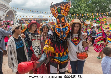 THAILAND - June 27 :Tourist take photo with Ghost maskl.Ghost Festival(Phi Ta Khon)is a type of masked procession celebrated on Buddhist merit- making holiday known in Thailand on Jun 27 2015.