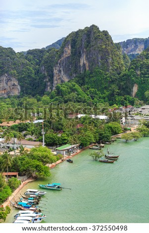 Thailand. Krabi province. Landscape with cliffs, sea, luxury resorts, traditional thai boats.