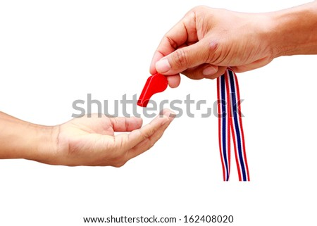 Thailand man hand put the red whistle for against government - stock photo