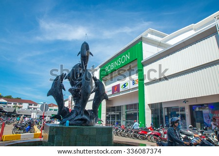 Thailand 2015 Nov 6, Foutain with dophine statue in front of Robinson departmentstore,Chantaburi town Thailand.  - stock photo