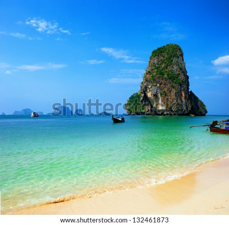Thailand ocean beach. Thai journey scenery landscape  with wooden boats, blue sky and clear sea water