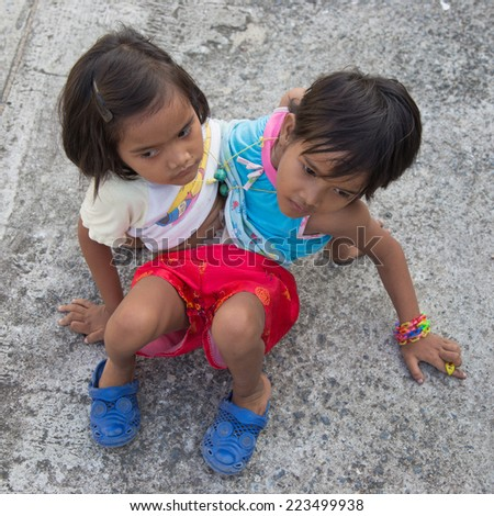 THAILAND-Oct 14:Pin and Pan, the alive siamese twins in Thailand,are 6-year-old-girls sharing their bodies with four hands and two legs on Oct 14,2014 in Nakhonsawan ,Thailand - stock photo