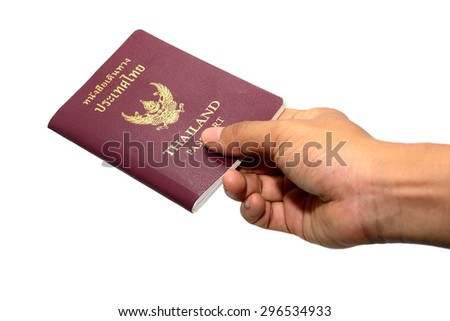 Thailand Passport and hand on white background