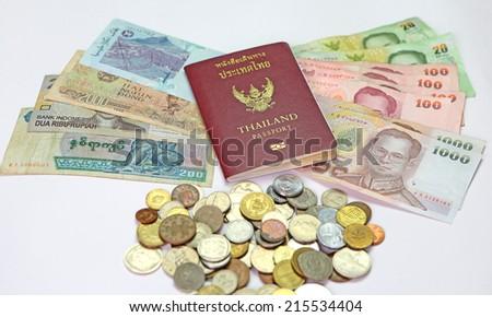 Thailand passport and money - stock photo