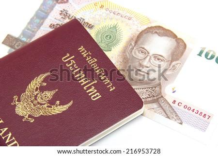 Thailand passport and money. - stock photo