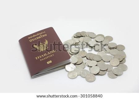 Thailand passport and Thai money  - stock photo