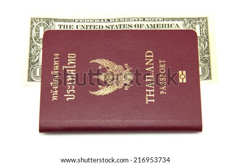 Thailand passport and the dollar. - stock photo