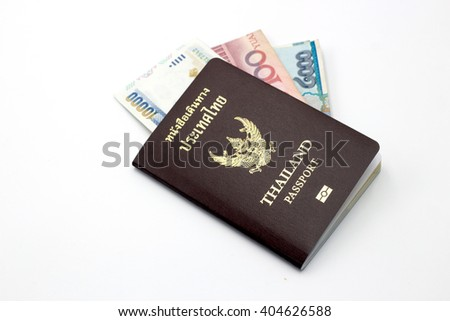 Thailand passport book and bank note on white isolate