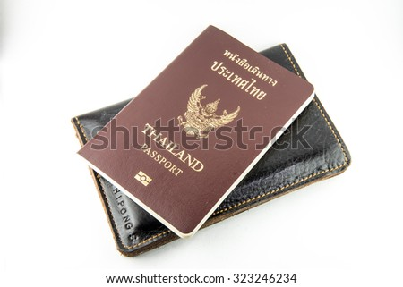 Thailand passport book on leather with isolate White Background