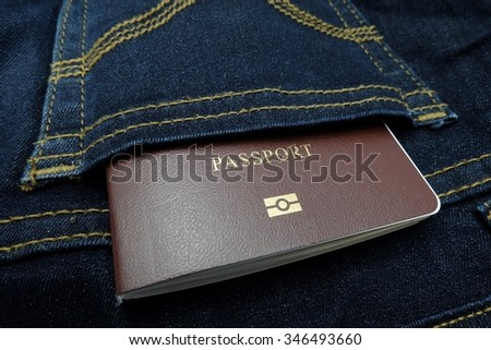 Thailand passport in back pocket jean pants.