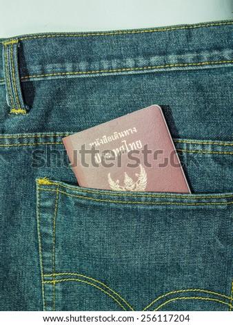Thailand passport in jeans pocket - stock photo