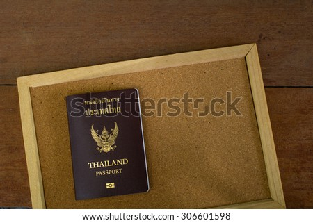 Thailand Passport on A Cork Bulletin Board with Selective Focus