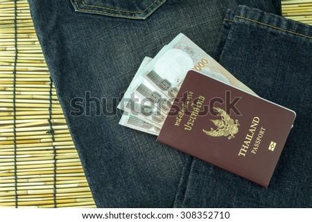 Thailand passport on pocket of jeans - stock photo