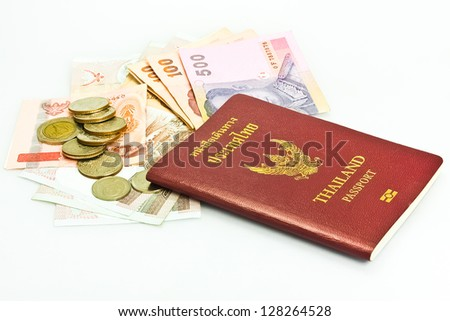 Thailand passport ,Thai  banknote and coin on white background - stock photo