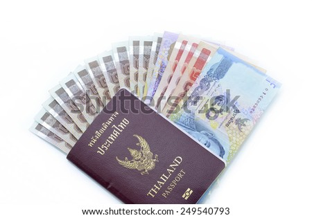 Thailand passport with Thai money ready to travel  isolated on white background