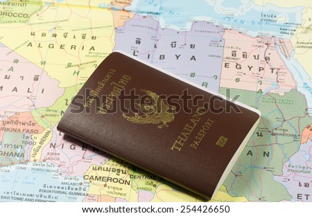 Thailand Passports on a map of the Algeria, Libya and Egypt. - stock photo