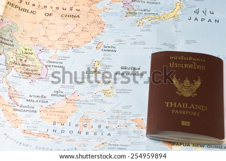Thailand Passports on a map of the China,Taiwan,Philippines and Japan. - stock photo