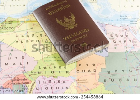 Thailand Passports on a map of the Niger, Chad, Sudan and Mali. - stock photo