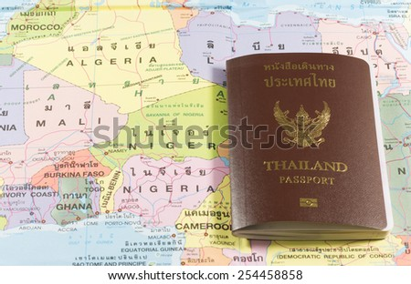Thailand Passports on a map of the Nigeria, Niger, Ghana and Mali. - stock photo