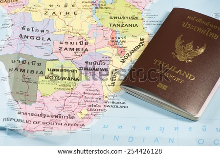 Thailand Passports on a map of the Zambia, Angola,Tanzania. - stock photo