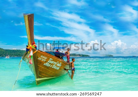 THAILAND, PHI PHI ISLANDS - NOVEMBER 1, 2014: Longtailed boat against azur water of Andaman Sea, Phi Phi Island, Thailand