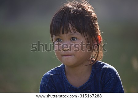 Thailand portrait of a pretty 5 year old Natural light. - stock photo