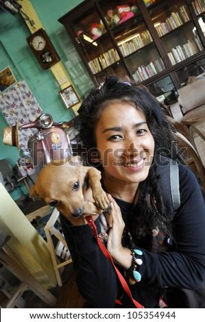 Thailand Reggae Women Carry Chihuahua Small - stock photo
