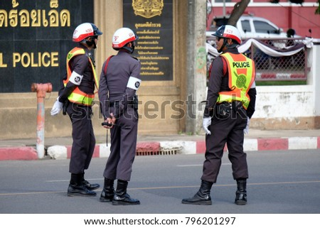 THAILAND, ROIET - JULY 8, 2017 : The traffic police on the street at santisuk, Road, Thailand. policeman regulating traffic on city streets