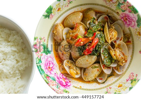 Thailand 's fried clams feed the ring in Thailand and overseas . In the country to taste the spicy food here . Eat with rice , very tasty background on white - stock photo