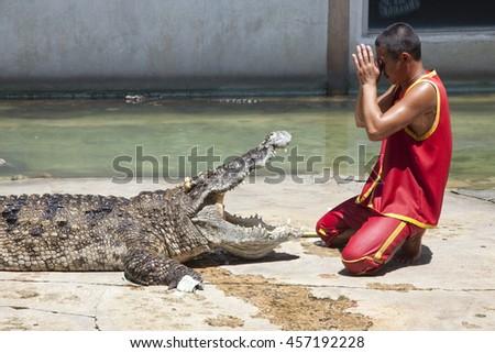 Thailand, Samut Prakan - July, 18, 2016 : Unidentified zoo keeper  at Samut Prakan Crocodile Farm and Zoo. - stock photo