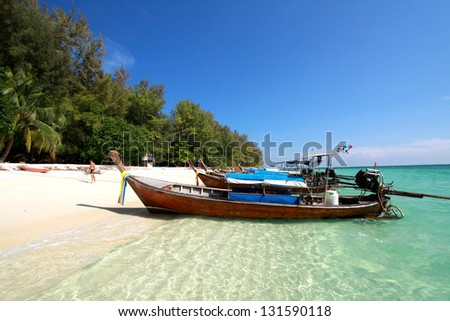Thailand sea landscape. Nature background with travel boat, sand, blue sky and clear ocean water - stock photo