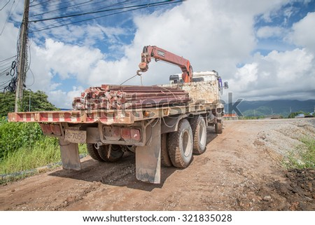 Thailand 2015 sep 27 , truck carried steel tube  bypass cannel and ,Construction site for flood protect Chantaburi town,Thailand  - stock photo