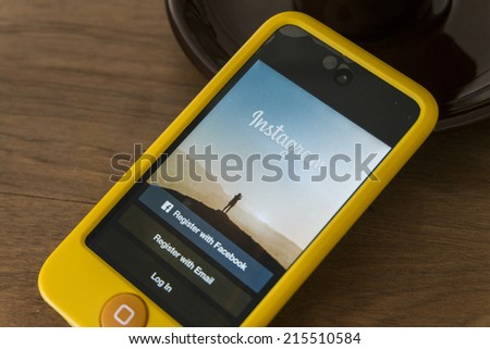 THAILAND - SEPTEMBER 05, 2014: Instagram login screen application on ipod apple product with wood background - stock photo