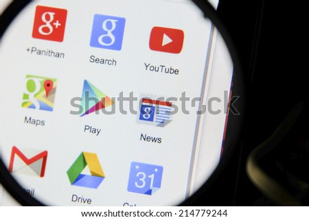 THAILAND - SEPTEMBER 2, 2014: Magnifying glass of Google product icon on webpage view on web browser. - stock photo