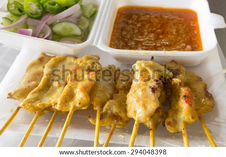 Thailand street food pork satay serve with sour and sweet sauce. - stock photo