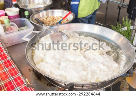 Thailand street food stir-fried squid eggs on the pan. - stock photo