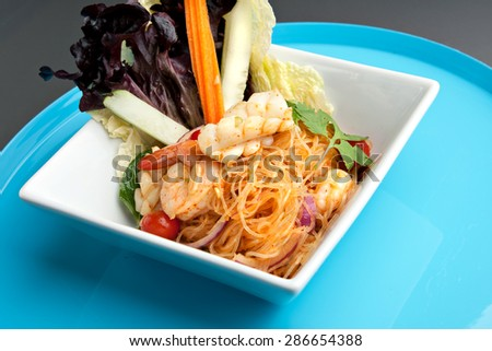Thailand style shrimp and seafood salad with veggies. - stock photo