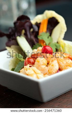 Thailand style shrimp and squid salad with veggies. - stock photo